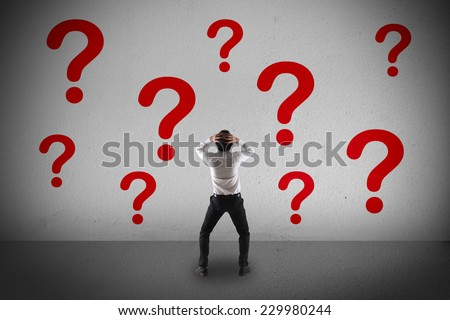 Confuse businessman and  question mark - stock photo