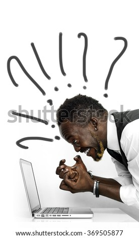 Confused african businessman portrait looking at laptop