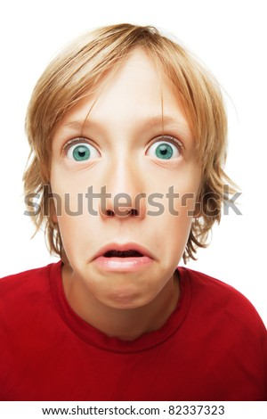 Confused and surprised young boy isolated on white background - stock photo