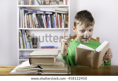 Confused boy student reading book