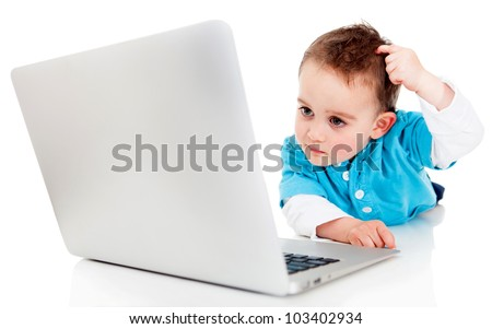 Confused boy with a laptop computer - isolated over a white background - stock photo