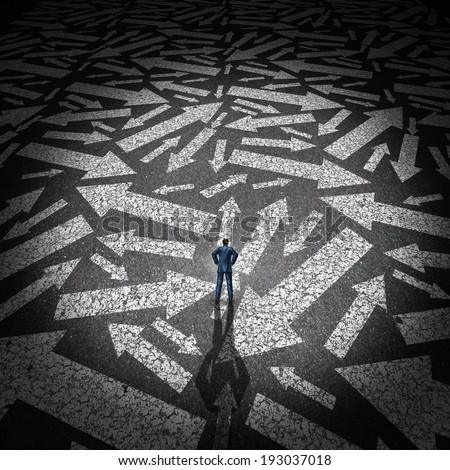 Confused businessman concept as a man standing on a road making a decision on a path to take with a group of arrows going in many directions as a business metaphor for strategy and planning crisis. - stock photo