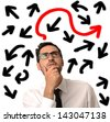 Confused businessman looking for the correct way - stock photo
