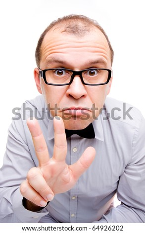 Confused businessman showing three fingers isolated on white - stock photo