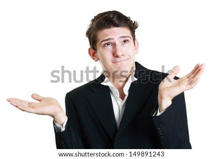 Confused caucasian man is unsure in studio, isolated on white