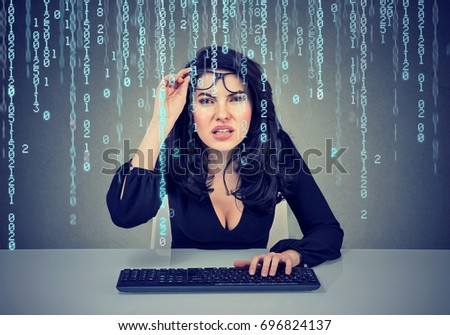 Confused girl coding on the computer