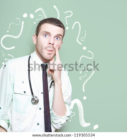 Confused Healthcare Doctor Standing Looking Puzzled Against A Green Question Mark Background In A Depiction Of A Unknown Cure Or Medical Mystery
