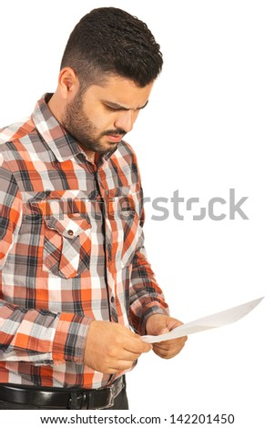 Confused man reading paper isolated on white background