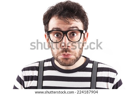 Confused nerd with retro glasses over white background - stock photo