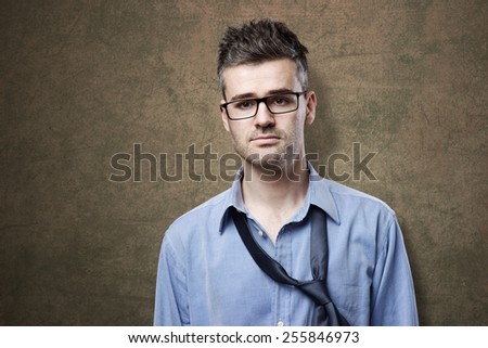 Confused untidy businessman posing, depression and unemployment concept