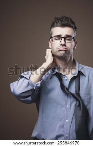 Confused untidy businessman with hand behind head, unemployment and depression concept - stock photo