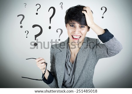 Confused Worried Businesswoman With Question Marks - stock photo