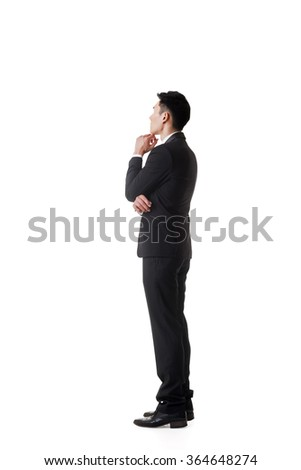 Confused young business man standing and thinking, full length portrait isolated - stock photo