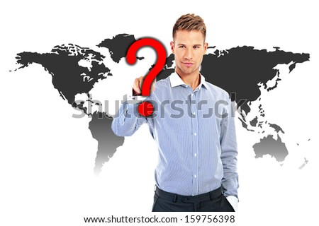 Confused, young businessman looking at many chalk drawn question marks - stock photo
