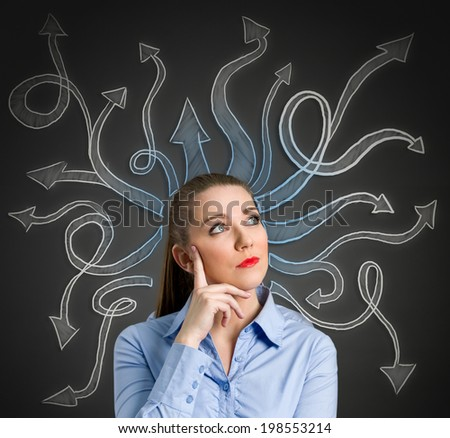 Confused, young businesswoman with many arrows pointed in different directions - stock photo