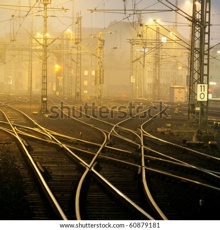 Confusing railway tracks at night. - stock photo