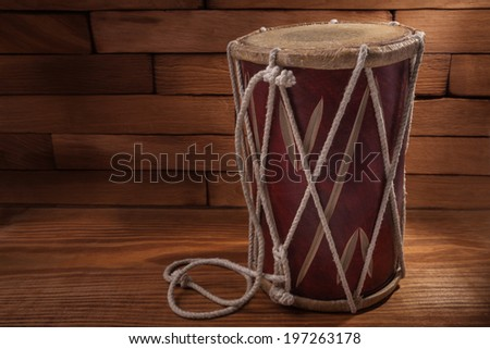 conga percussion drum instrument on wooden boards - stock photo