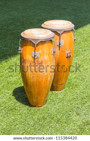 Congas in the grass field, for sport (football) cheering - stock photo