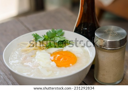 Congee of traditional food Chinese style with soft-boiled egg