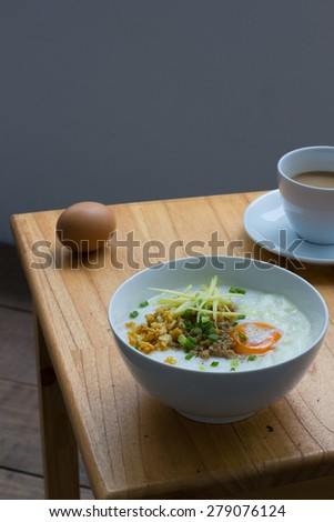 Congee of traditional food Chinese style with soft-boiled egg - stock photo