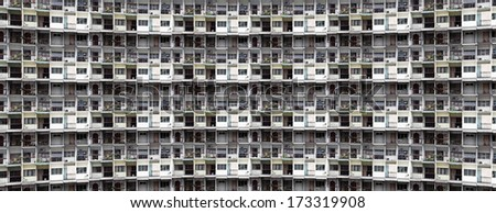 Congested facade of a concrete tenement building for concept of urban living.  - stock photo