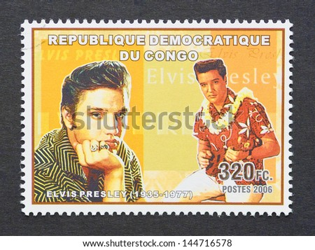 CONGO - CIRCA 2006: a postage stamp printed in Congo showing an image of Elvis Presley, circa 2006. - stock photo