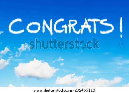 congrats! written in the sky with contrails - stock photo