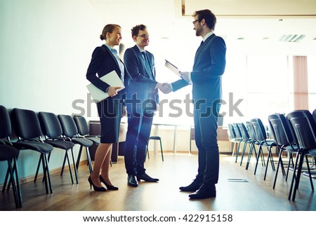 Congratualting speaker after the conference - stock photo