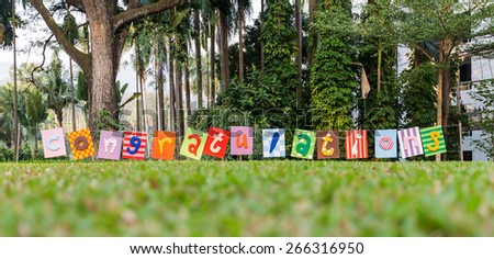Congratulations with letters Many colors on a Nature background. - stock photo