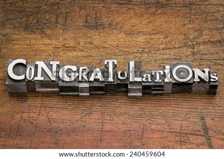 congratulations  word in mixed vintage metal type printing blocks over grunge wood - stock photo