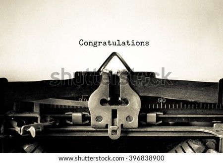 Congratulations word typed on a vintage typewriter