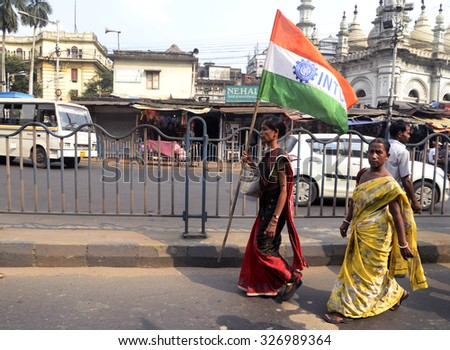 Congress woman supporter march with Congress trade union flag during a protest rally organized by West Bengal Pradesh Congress on September 30, 2015 in Calcutta, India.    - stock photo