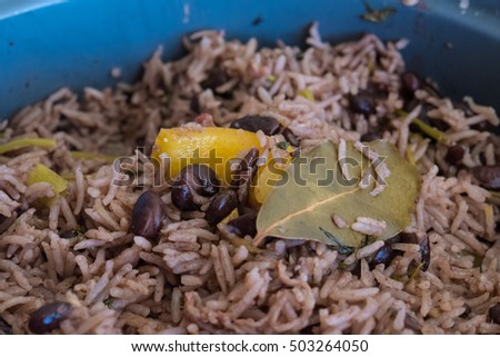Congri rice or Arroz Congri which is a Cuban Style Rice. The rice is cooked in a soup of black beans and so it takes their color.