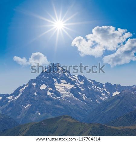 conical mount under a sparkle sun - stock photo