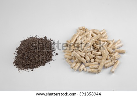Conifer wood pellets and their ash on a white background - stock photo