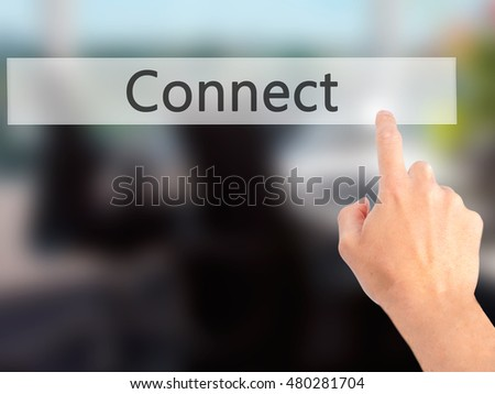 Connect - Hand pressing a button on blurred background concept . Business, technology, internet concept. Stock Photo