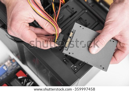 Connect the SSD hard drive to the computer. - stock photo