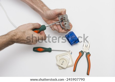 Connect the wires to the power outlet. - stock photo