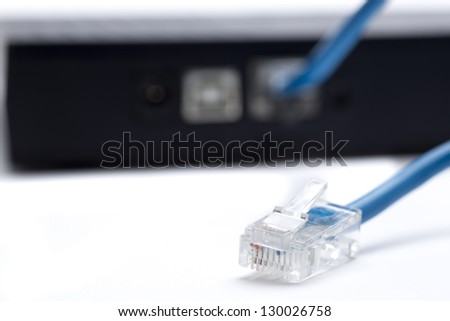 connecting cable Internet line, to the modem - stock photo