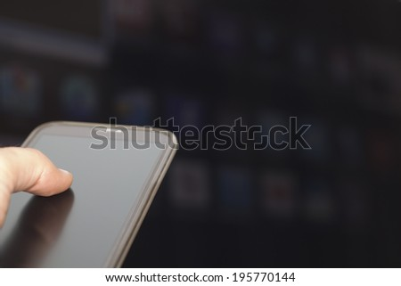 Connecting the Mobile Phone with a Television - stock photo