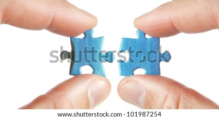 Connecting two puzzles. On a white background. - stock photo