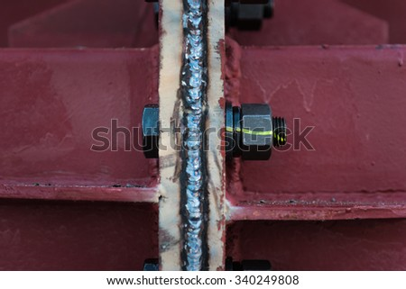 Connection of the steel structure with high tension bolts and welding. - stock photo