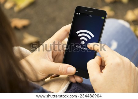 connectivity concept: wifi zone sign on phone screen - stock photo