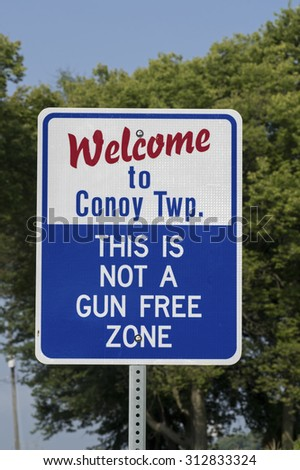 CONOY TOWNSHIP, PA, USA-SEPTEMBER 3, 2015:  Roadside sign stating that the township is not gun free. The sign is popular with gun owners and supporters of the second amendment to the Constitution.