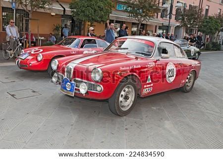 "CONSELICE, RA, ITALY - SEPTEMBER 21: the crew Monti - Ballerio on Alfa Romeo Giulietta Sprint Veloce (1961) in classic car race ""Gran Premio Nuvolari"" on September 21, 2014 in Conselice, RA, Italy  - stock photo"