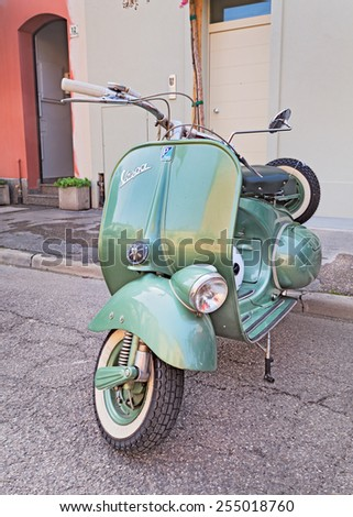 """CONSELICE, RA, ITALY - SEPTEMBER 21: vintage Iralian scooter Vespa in rally for classic cars and motorcycle """"Raduno d'auto e moto d'epoca"""" on September 21, 2014 in Conselice, RA, Italy - stock photo"""
