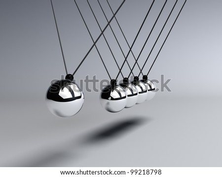 Conservation of energy is demonstrated with a Newtons Cradle in motion - stock photo