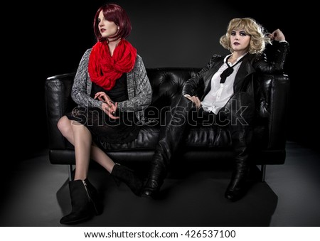 Conservative female model snobbish to a younger model in goth punk fashion clothing