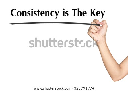 Consistency is The Key Man hand writing virtual screen text on white background - stock photo