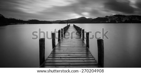 Consiton Water Jetty at Sunset, Lake District, Lancashire - stock photo